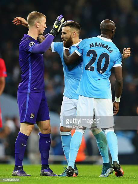 Joe Hart of Manchester City celebrates with Nicolas Otamendi and Eliaquim Mangala of Manchester City after the UEFA Champions League Group D match...