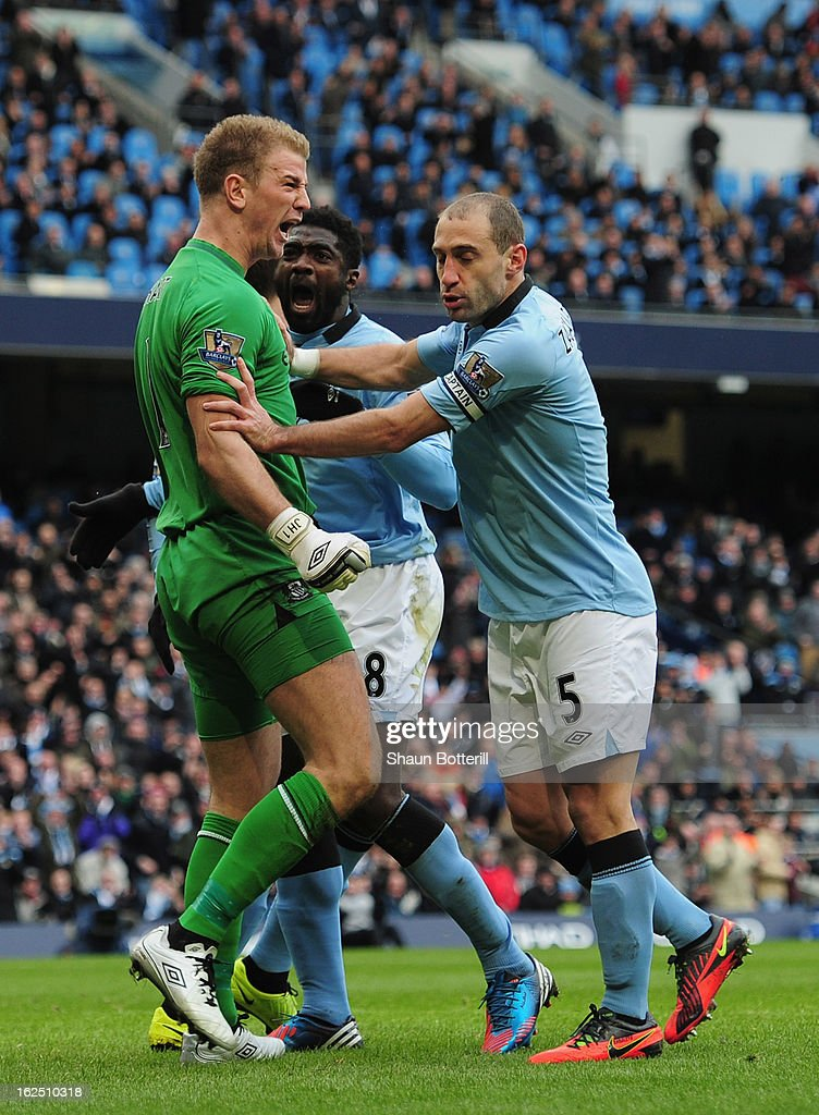 <a gi-track='captionPersonalityLinkClicked' href=/galleries/search?phrase=Joe+Hart&family=editorial&specificpeople=1295472 ng-click='$event.stopPropagation()'>Joe Hart</a> of Manchester City celebrates with team-mates Pablo Zabaleta and Kolo Toure after saving a penalty during the Barclays Premier League match between Manchester City and Chelsea at Etihad Stadium on February 24, 2013 in Manchester, England.