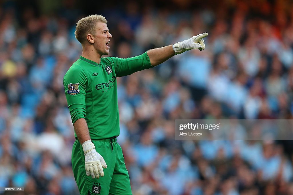 Joe Hart of Manchester City gestures during the Barclays Premier League match between Manchester City and West Bromwich Albion at the Etihad Stadium on May 07, 2013 in Manchester, England.