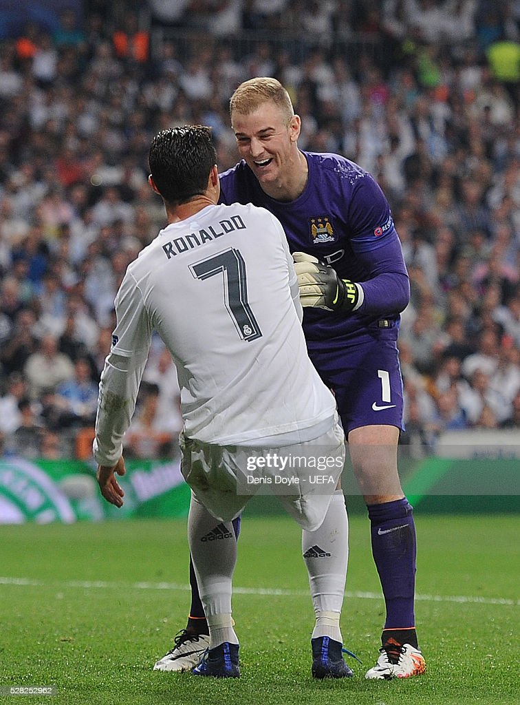 Joe Hart of Manchester City helps Cristiano Ronaldo of Real Madrid to his feet during the UEFA Champions League Semi Final second leg match between Real Madrid and Manchester City FC at Estadio Santiago Bernabeu on May 4, 2016 in Madrid, Spain.