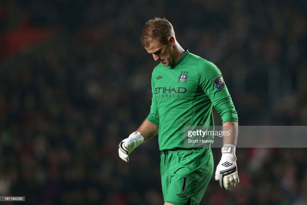 <a gi-track='captionPersonalityLinkClicked' href=/galleries/search?phrase=Joe+Hart&family=editorial&specificpeople=1295472 ng-click='$event.stopPropagation()'>Joe Hart</a> of Manchester City looks dejected after Man City conceded their second goal during the Barclays Premier League match between Southampton and Manchester City at St Mary's Stadium on February 9, 2013 in Southampton, England.