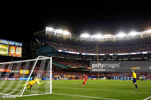 Joe Hart of Manchester City makes a save during the penlty kick against Liverpool during the International Champions Cup 2014 at Yankee Stadium on...