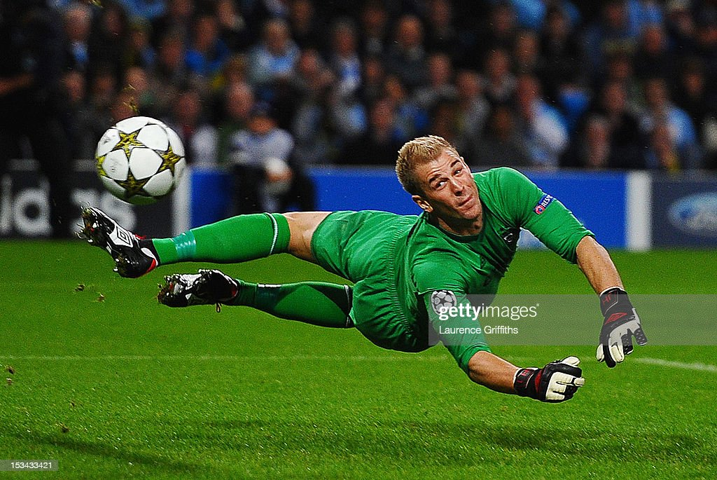 <a gi-track='captionPersonalityLinkClicked' href=/galleries/search?phrase=Joe+Hart&family=editorial&specificpeople=1295472 ng-click='$event.stopPropagation()'>Joe Hart</a> of Manchester City makes a save during the UEFA Champions League Group D match between Manchester City and Borussia Dortmund at the Etihad Stadium on October 3, 2012 in Manchester, England.