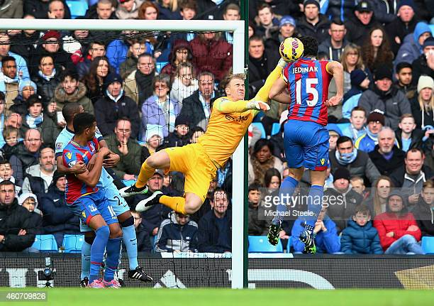 Joe Hart of Manchester City makes a save from Mile Jedinak of Crystal Palace during the Barclays Premier League match between Manchester City and...