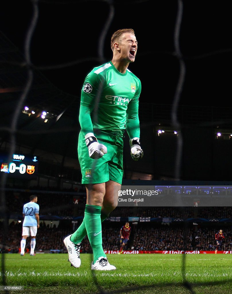 Joe Hart of Manchester City reacts after Lionel Messi of Barcelona scored the opening goal from a penalty kick during the UEFA Champions League Round of 16 first leg match between Manchester City and Barcelona at the Etihad Stadium on February 18, 2014 in Manchester, England.