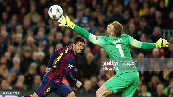 Joe Hart of Manchester City saves a headed shot from Luis Suarez of FC Barcelona during the UEFA Champions League Round of 16 second leg match...