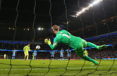 Joe Hart of Manchester City saves a penalty from Lionel Messi of Barcelona during the UEFA Champions League Round of 16 match between Manchester City...