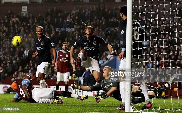 Joe Hart of Manchester City saves a shot from Darren Bent of Aston Villa during the Barclays Premier League match between Aston Villa and Manchester...