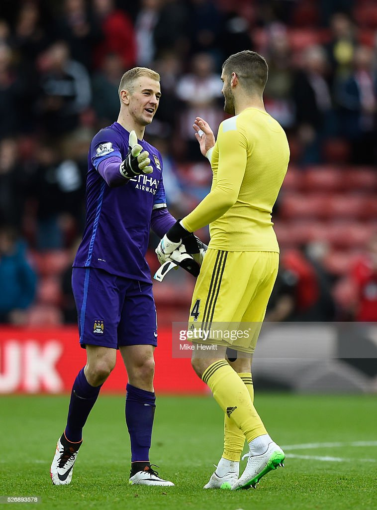 <a gi-track='captionPersonalityLinkClicked' href=/galleries/search?phrase=Joe+Hart&family=editorial&specificpeople=1295472 ng-click='$event.stopPropagation()'>Joe Hart</a> of Manchester City shakes hands with <a gi-track='captionPersonalityLinkClicked' href=/galleries/search?phrase=Fraser+Forster&family=editorial&specificpeople=4185429 ng-click='$event.stopPropagation()'>Fraser Forster</a> of Southampton after the Barclays Premier League match between Southampton and Manchester City at St Mary's Stadium on May 1, 2016 in Southampton, England.