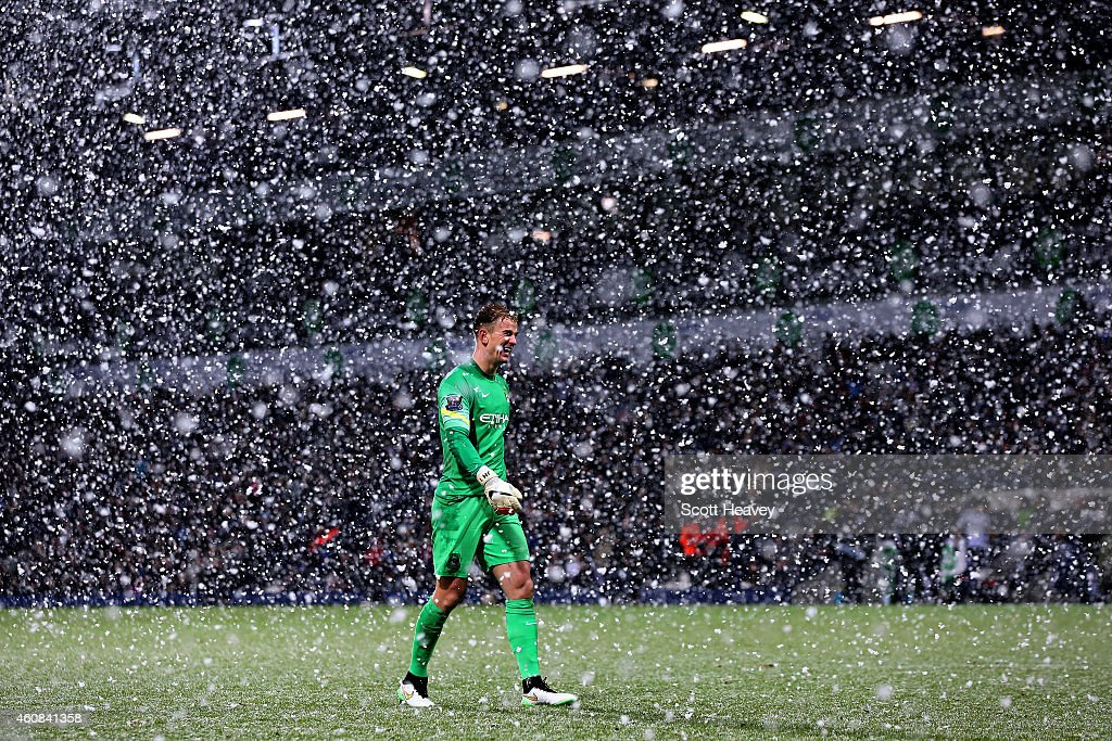 Joe Hart of Manchester City walks through the snow during the Barclays Premier League match between West Bromwich Albion and Manchester City at The...