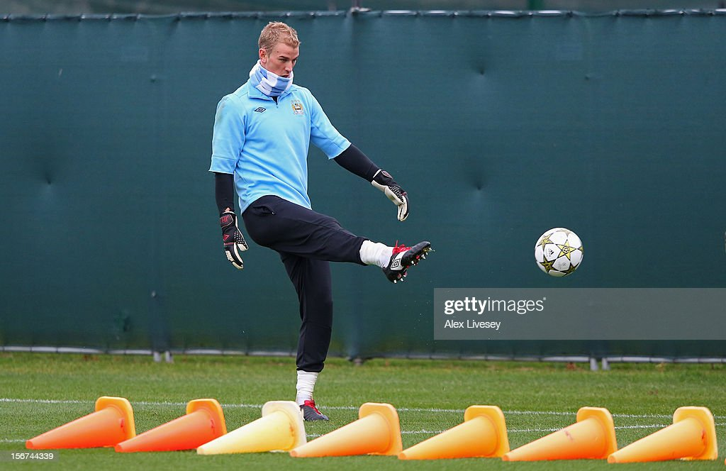 Joe Hart of Manchester City warms up during a training session at Carrington Training Ground on November 20, 2012 in Manchester, England.