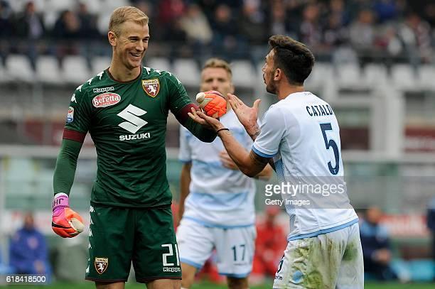 Joe Hart of Torino and Danilo Cataldi of Lazio during the Serie A match between FC Torino and SS Lazio at Stadio Olimpico di Torino on October 23...