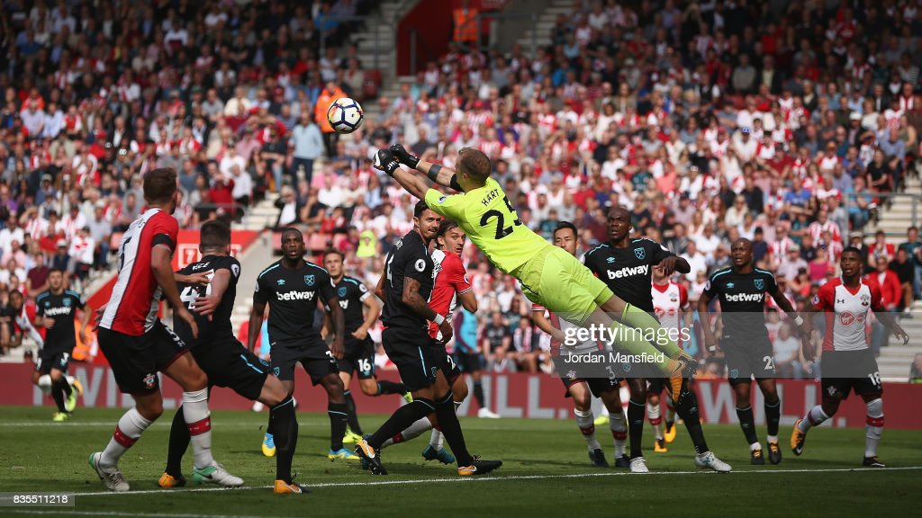 Joe Hart of West Ham United dives to punch the ball during the Premier League match between Southampton and West Ham United at St Mary's Stadium on August 19, 2017 in Southampton, England.