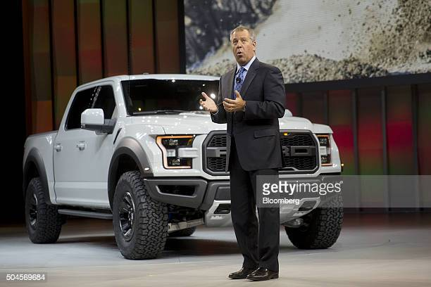 Joe Hinrichs executive vice president and president of the Americas of Ford Motor Co speaks while standing next to a Ford F150 Raptor pick up truck...