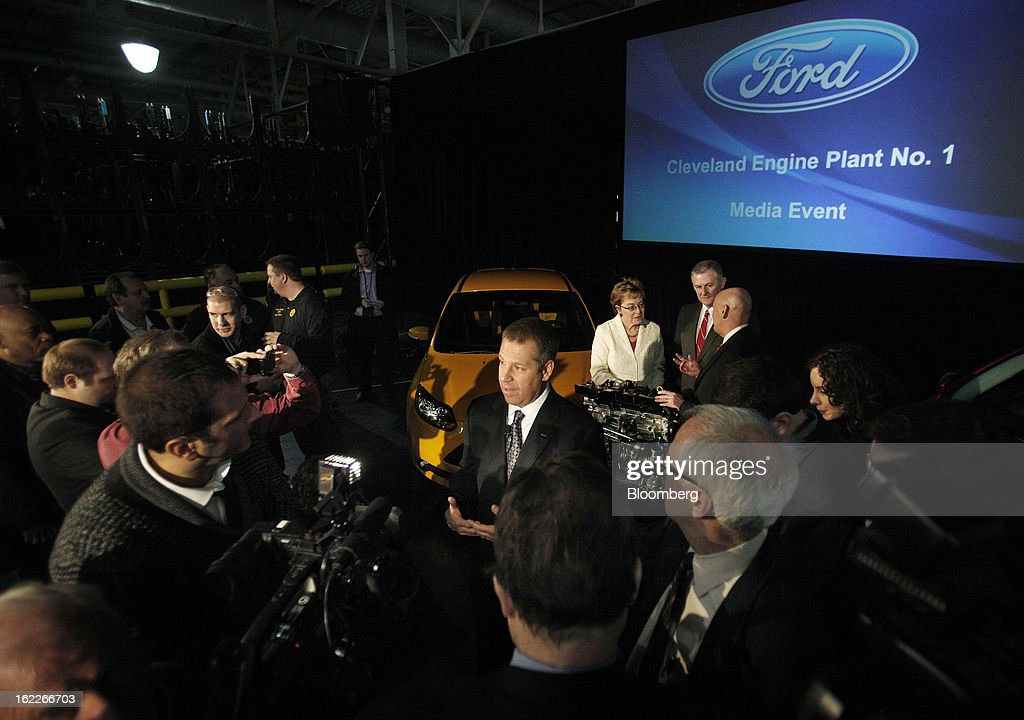 Joe Hinrichs, president of the Americas for Ford Motor Co., center, speaks to the media during an event at the company's Cleveland Engine Plant in Brook Park, Ohio, U.S., on Thursday, February 21, 2013. Ford Motor Co. said it will invest $200 million to make four-cylinder engines at the plant starting in late 2014 as the second-largest U.S. automaker equips an increasing number of models with smaller, more fuel-efficient powertrains. Photographer: David Maxwell/Bloomberg via Getty Images