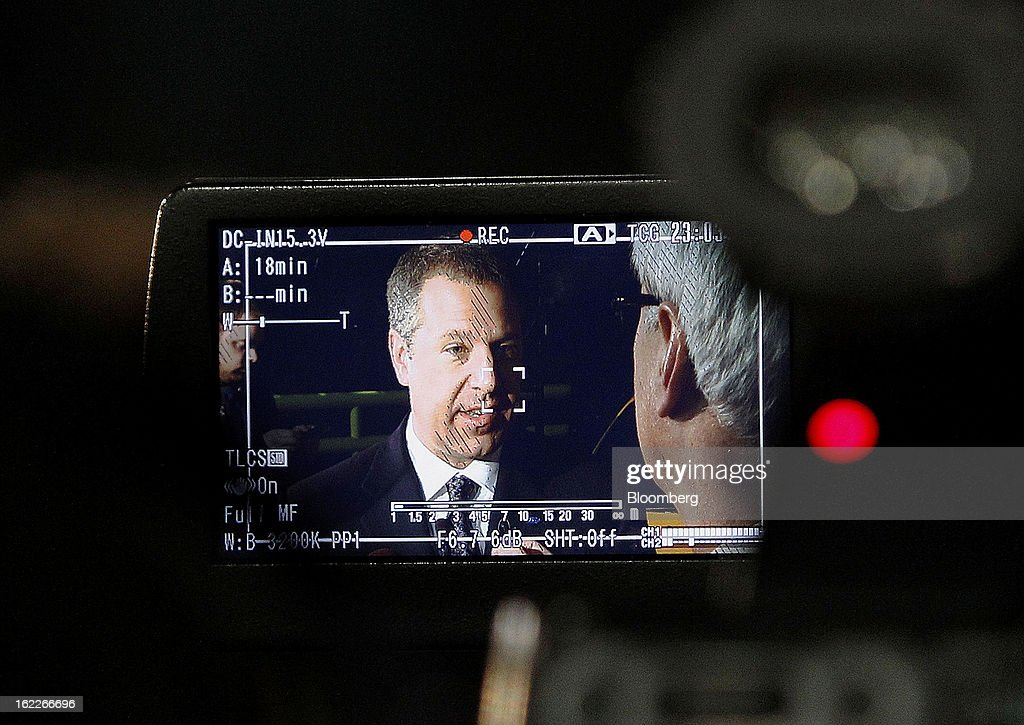 Joe Hinrichs, president of the Americas for Ford Motor Co., is seen through the viewfinder of a television camera while speaking to the media during an event at the company's Cleveland Engine Plant in Brook Park, Ohio, U.S., on Thursday, February 21, 2013. Ford Motor Co. said it will invest $200 million to make four-cylinder engines at the plant starting in late 2014 as the second-largest U.S. automaker equips an increasing number of models with smaller, more fuel-efficient powertrains. Photographer: David Maxwell/Bloomberg via Getty Images