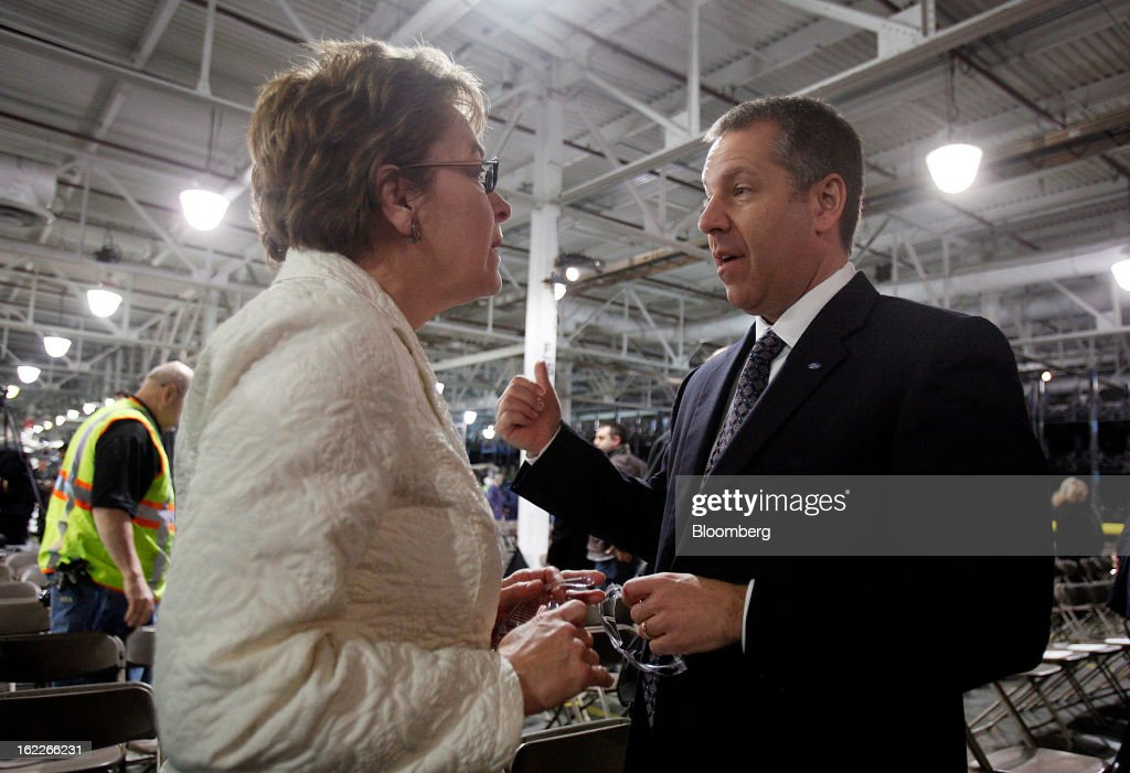 Joe Hinrichs, president of the Americas for Ford Motor Co., right, speaks with U.S. Representative Marcy Kaptur, a Democrat from Ohio, during an event at the Ford Motor Cleveland Engine Plant in Brook Park, Ohio, U.S., on Thursday, February 21, 2013. Ford Motor Co. said it will invest $200 million to make four-cylinder engines at the plant starting in late 2014 as the second-largest U.S. automaker equips an increasing number of models with smaller, more fuel-efficient powertrains. Photographer: David Maxwell/Bloomberg via Getty Images