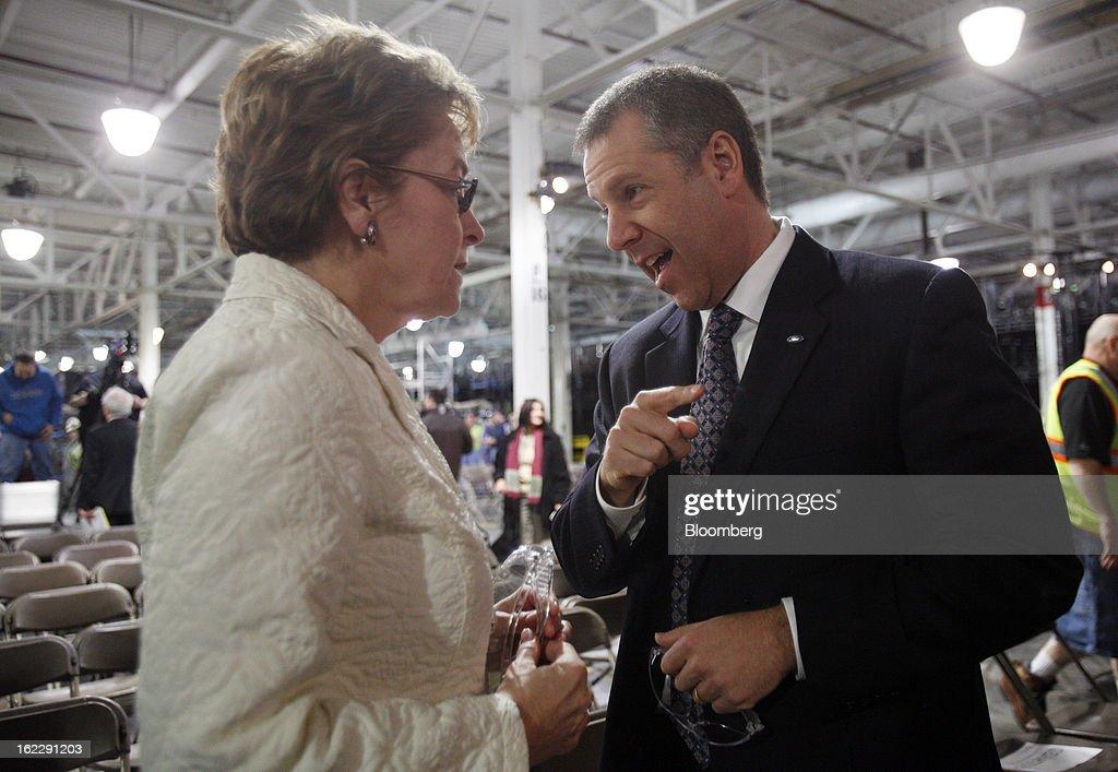 Joe Hinrichs, president of the Americas for Ford Motor Co., right, speaks with U.S. Representative Marcy Kaptur, a Democrat from Ohio, during an event at the Ford Motor Cleveland Engine Plant in Brook Park, Ohio, U.S., on Thursday, Feb. 21, 2013. Ford Motor Co. said it will invest $200 million to make four-cylinder engines at the plant starting in late 2014 as the second-largest U.S. automaker equips an increasing number of models with smaller, more fuel-efficient powertrains. Photographer: David Maxwell/Bloomberg via Getty Images