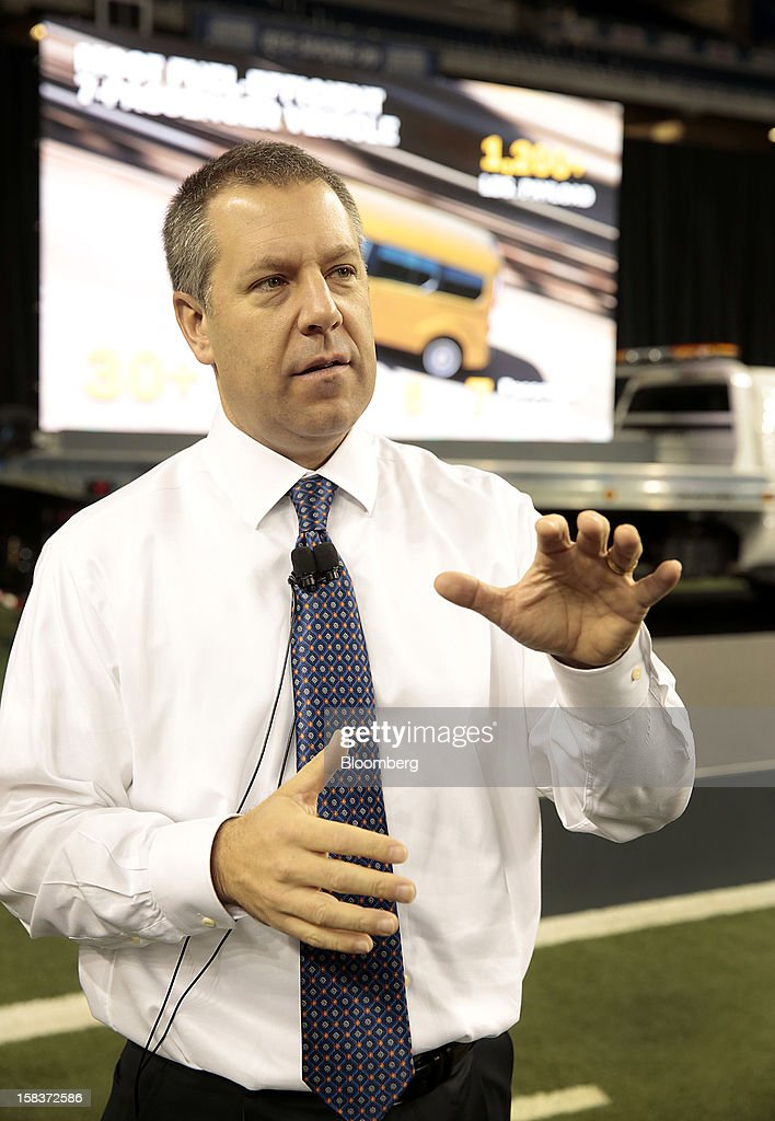 Joe Hinrichs, president of the Americas for Ford Motor Co., speaks during an event at Ford Field in Detroit, Michigan, U.S., on Friday, Dec. 14, 2012. Ford Motor Co. is talking to the U.S. Environmental Protection Agency about how it tests fuel economy performance on new vehicles following reports that the automaker's hybrids are falling short of mileage promises. Photographer: Jeff Kowalsky/Bloomberg via Getty Images