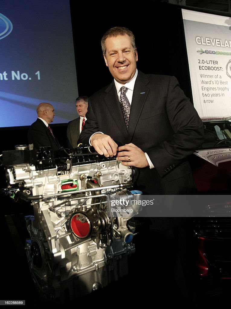 Joe Hinrichs, president of the Americas for Ford Motor Co., stands for a photograph next to a 2.0 liter ecoboost engine during an event at the company's Cleveland Engine Plant in Brook Park, Ohio, U.S., on Thursday, February 21, 2013. Ford Motor Co. said it will invest $200 million to make four-cylinder engines at the plant starting in late 2014 as the second-largest U.S. automaker equips an increasing number of models with smaller, more fuel-efficient powertrains. Photographer: David Maxwell/Bloomberg via Getty Images
