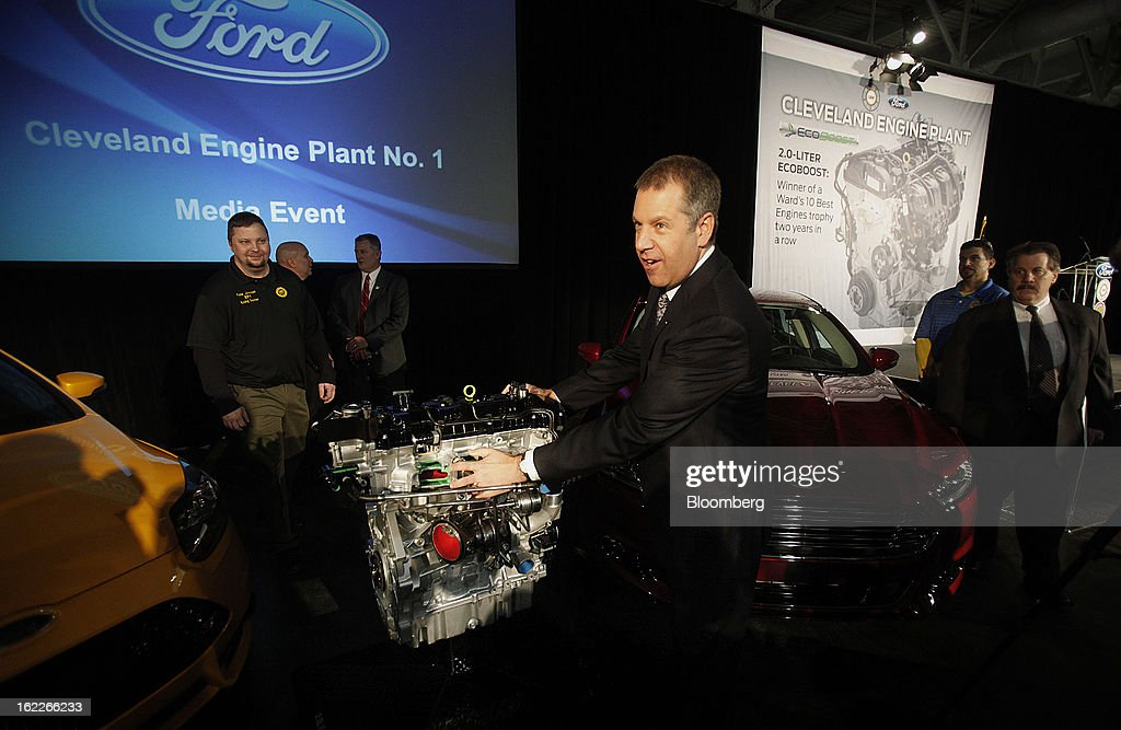 Joe Hinrichs, president of the Americas for Ford Motor Co., views a 2.0 liter ecoboost engine during an event at the company's Cleveland Engine Plant in Brook Park, Ohio, U.S., on Thursday, February 21, 2013. Ford Motor Co. said it will invest $200 million to make four-cylinder engines at the plant starting in late 2014 as the second-largest U.S. automaker equips an increasing number of models with smaller, more fuel-efficient powertrains. Photographer: David Maxwell/Bloomberg via Getty Images