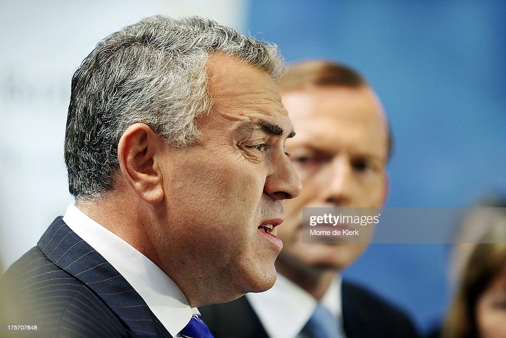 Joe Hockey and Opposition Leader <a gi-track='captionPersonalityLinkClicked' href=/galleries/search?phrase=Tony+Abbott&family=editorial&specificpeople=220956 ng-click='$event.stopPropagation()'>Tony Abbott</a> speak to the media at a press conference at the Bickfords facility in Salisbury South, on August 7, 2013 in Adelaide, Australia. Mr Abbott is campaigning in Adelaide today announcing a proposed 1.5% tax rate cut for business if elected in the upcoming 2013 Federal Election on September 7th.