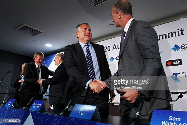 Joe Hockey Australian Treasurer and John Rice CEO GE Global Growth shake hands following a press conference during the B20 Summit at on July 18 2014...