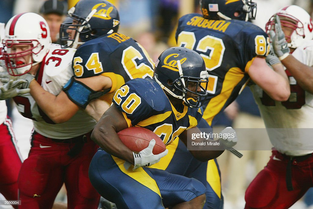 Joe Igber of the California Golden Bears looks for an opening in the line during the 105th Big Game against the Stanford Cardinal at Memorial Stadium...