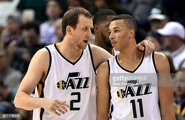 Joe Ingles and Dante Exum of the Utah Jazz converse in the second half of their 10086 loss to the San Antonio Spurs at Vivint Smart Home Arena on...