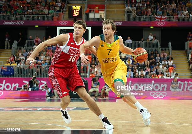 Joe Ingles of Australia drives the ball past Victor Khryapa of Russia during the Men's Basketball Preliminary Round match on Day 10 of the London...
