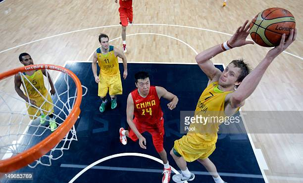 Joe Ingles of Australia goes over Wang Zhizhi of China during the Men's Basketball Preliminary Round on Day 6 of the London 2012 Olympic Games at...