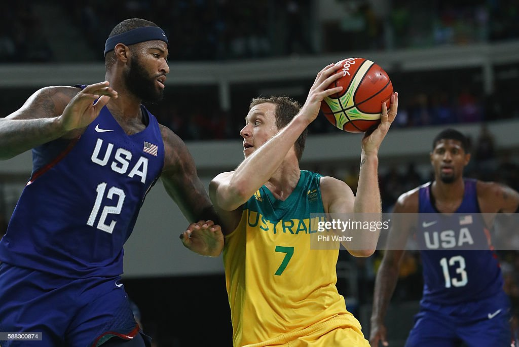 Joe Ingles #7 of Australia handles the bal against Demarcus Cousins #12 of United States as Paul George #13 looks on during the Men's Preliminary Round Group A between Australia and the United States on Day 5 of the Rio 2016 Olympic Games at Carioca Arena 1 on August 10, 2016 in Rio de Janeiro, Brazil.