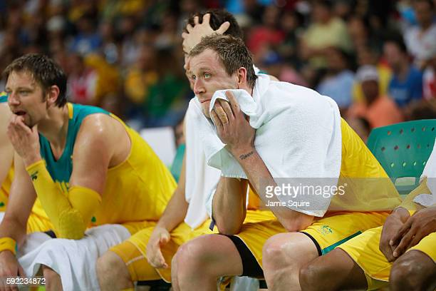 Joe Ingles of Australia reacts on the bench during the Men's Semifinal match against Serbia on Day 14 of the Rio 2016 Olympic Games at Carioca Arena...