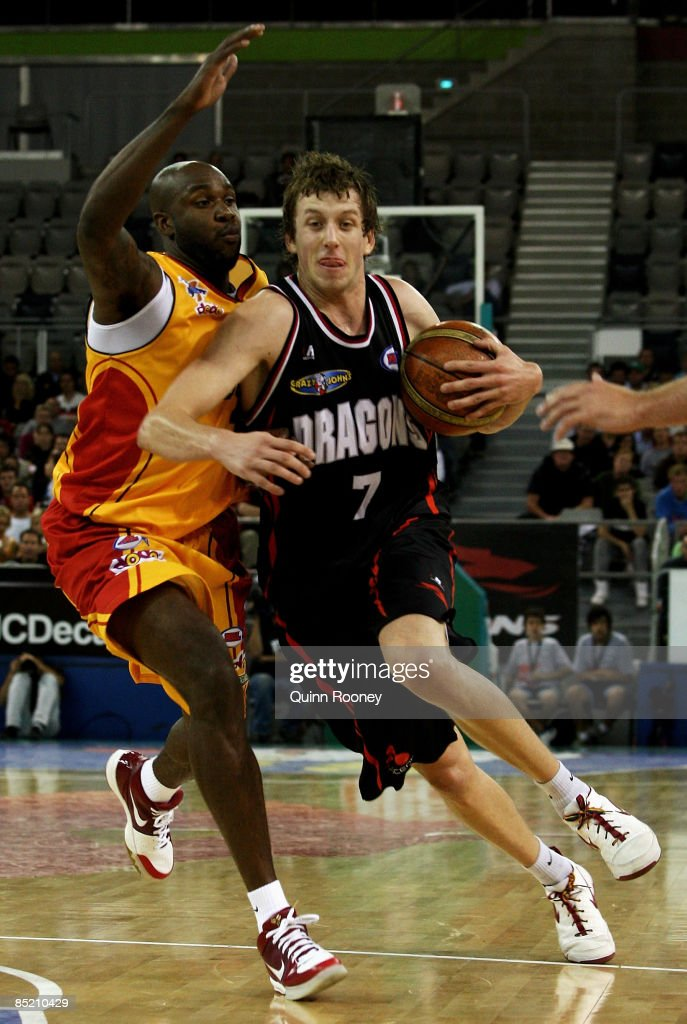 <a gi-track='captionPersonalityLinkClicked' href=/galleries/search?phrase=Joe+Ingles&family=editorial&specificpeople=3868025 ng-click='$event.stopPropagation()'>Joe Ingles</a> of the Dragons attempts to get passed Ebi Ere of the Tigers during the game one NBL final match between the South Dragons and the Melbourne tigers held at Hisense Arena March 4, 2009 in Melbourne, Australia.