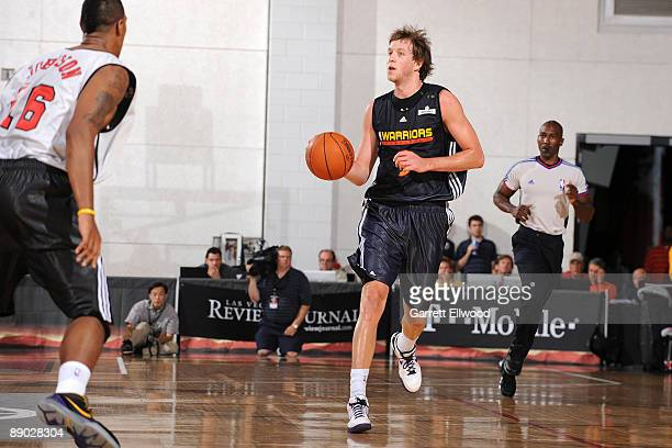 Joe Ingles of the Golden State Warriors brings the ball up court against James Johnson of the Chicago Bulls during NBA Summer League presented by EA...