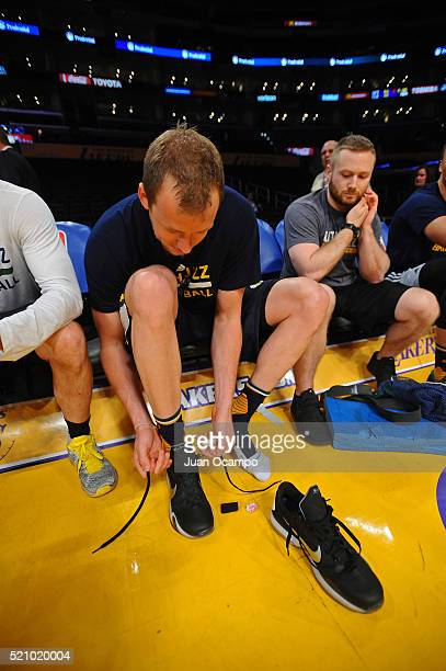 Joe Ingles of the Los Angeles Lakers laces up his commemorative Mamba Day sneakers before the game against the Los Angeles Lakers on April 13 2016 at...