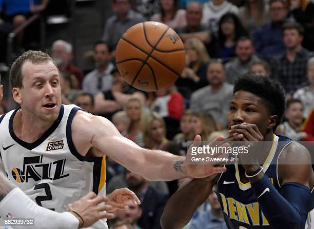 Joe Ingles of the Utah Jazz and Malik Beasley of the Denver Nuggets look to the loose ball in the second half of the 10696 win by the Jazz at Vivint...