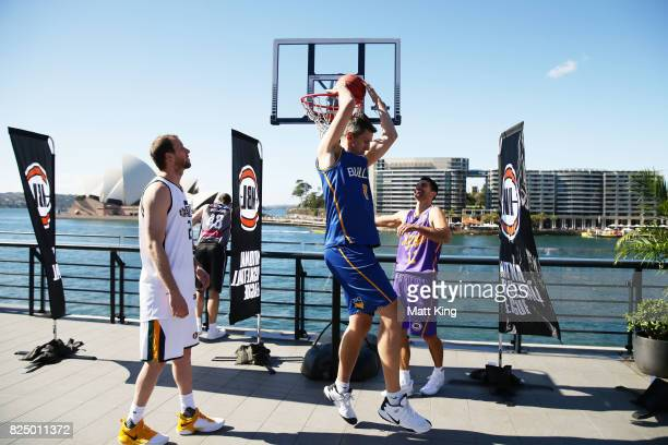 Joe Ingles of the Utah Jazz Chris Goulding of Melbourne United Daniel Kickert of the Bisbane Bullets and Kevin Lisch of the Sydney Kings shoot...