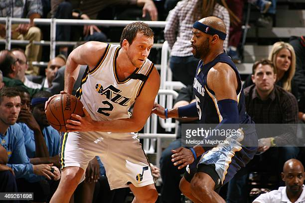 Joe Ingles of the Utah Jazz defends the ball against Vince Carter of the Memphis Grizzlies during the game on April 10 2015 at EnergySolutions Arena...