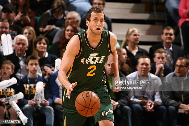 Joe Ingles of the Utah Jazz dribbles against the Portland Trail Blazers on March 25 2015 at EnergySolutions Arena in Salt Lake City Utah NOTE TO USER...