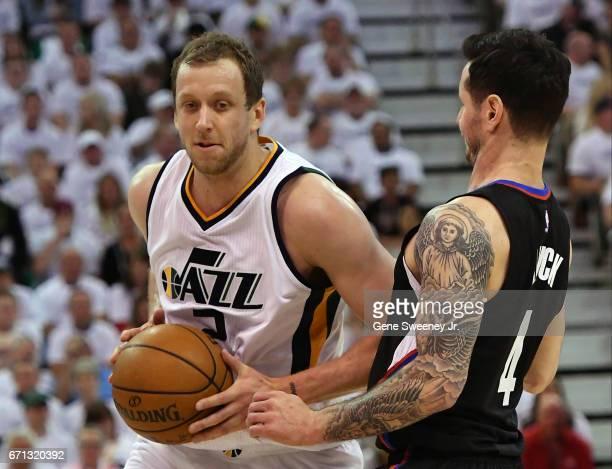 Joe Ingles of the Utah Jazz elbows his way past JJ Redick of the Los Angeles Clippers in the first half in Game Three of the Western Conference...