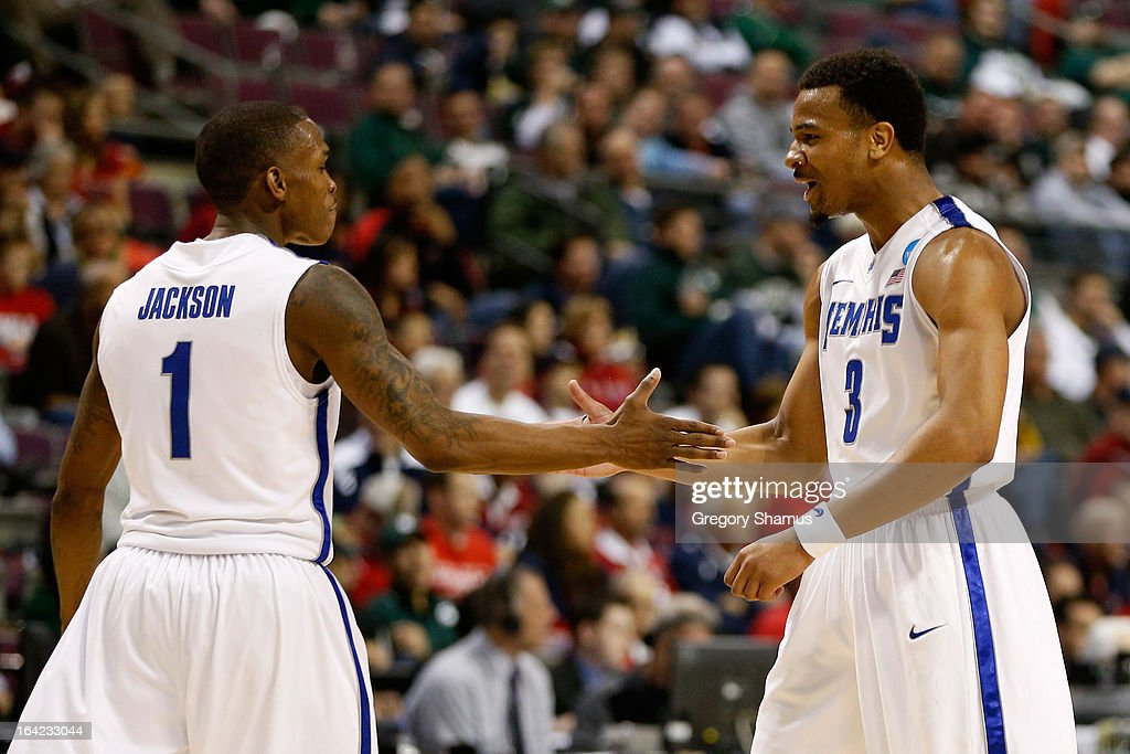 Joe Jackson #1 and Chris Crawford #3 of the Memphis Tigers react to a play against the St. Mary's Gaels during the second round of the 2013 NCAA Men's Basketball Tournament at at The Palace of Auburn Hills on March 21, 2013 in Auburn Hills, Michigan.