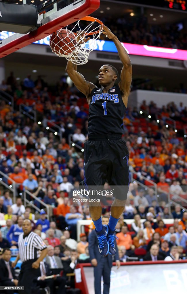 Joe Jackson of the Memphis Tigers dunks the ball in the first half against the Virginia Cavaliers during the third round of the 2014 NCAA Men's...