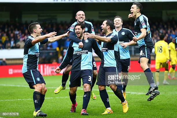 Joe Jacobson of Wycombe Wanderers celebrates scoring his team's first goal from the penalty spot with his team mates during the Emirates FA Cup Third...
