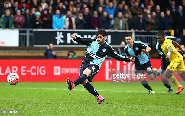 Joe Jacobson of Wycombe Wanderers converts the penalty to score his team's first goal during the Emirates FA Cup Third Round match between Wycombe...