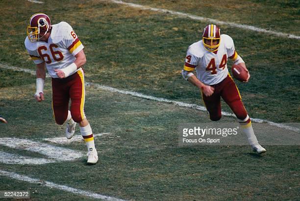 Joe Jacoby of the Washington Redskins blocks for John Riggins during a circa 1984 game