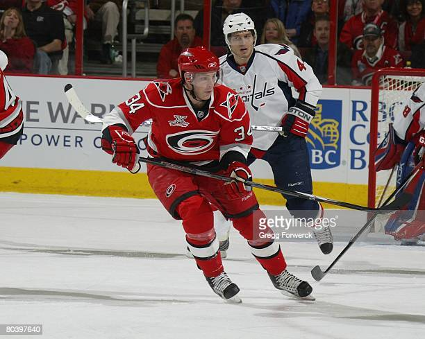 Joe Jensen of the Carolina Hurricanes skates through the offensive zone during the NHL game against the Washington Capitals on March 25 2008 at RBC...