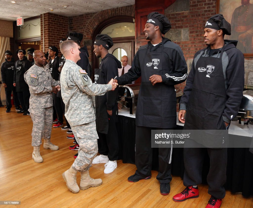 Joe Johnson #7 and Andray Blatche #0 of the Brooklyn Nets poses for a picture during a team event in celebration of Veterans Day at Ft. Hamilton, Brooklyn on November 11, 2013 in the Brooklyn borough of New York City.