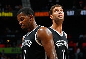 Joe Johnson and Brook Lopez of the Brooklyn Nets react in the final minutes of their 10187 loss to the Atlanta Hawks at Philips Arena on November 4...