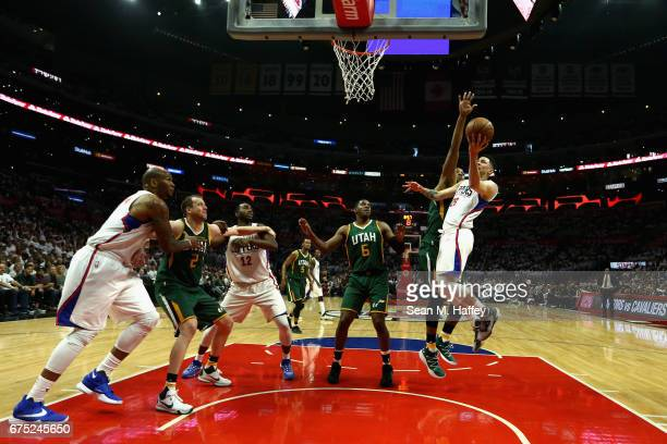 Joe Johnson and Joe Ingles of the Utah Jazz look to rebound as Austin Rivers shoots and Luc Mbah a Moute and Marreese Speights of the Los Angeles...